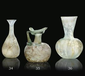 A ROMAN BLOWN CLEAR GLASS FLAS