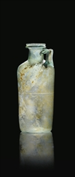 A ROMAN GREEN BLOWN GLASS CYLI