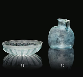 A ROMAN BLUE BLOWN GLASS FOUR-