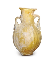 A ROMAN YELLOW MOULD-BLOWN GLA