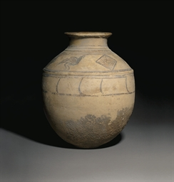 A PERSIAN POTTERY JAR
