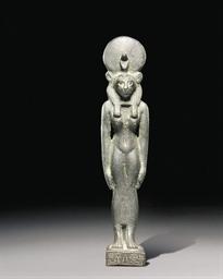AN EGYPTIAN BRONZE FIGURE OF S
