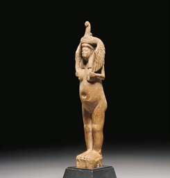 AN EGYPTIAN WOOD FIGURE OF ISI