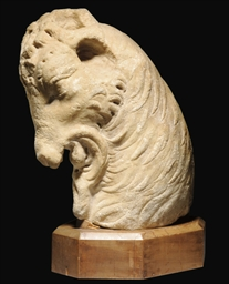 A ROMAN MARBLE HEAD OF A GOAT