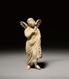 A HELLENISTIC TERRACOTTA FIGUR