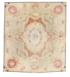 A large antique Aubusson carpe
