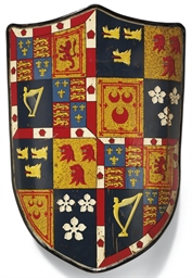 A PAINTED-TIN ARMORIAL SHIELD