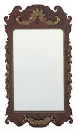 A GEORGE II WALNUT FRET MIRROR
