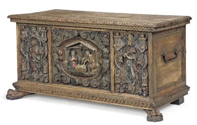 AN ITALIAN CARVED WALNUT CHEST