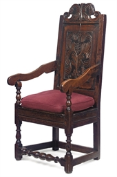 AN OAK PANEL-BACK ARMCHAIR