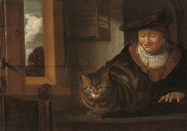 A man stroking a cat in an int