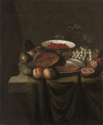 A bowl of cherries, a melon on