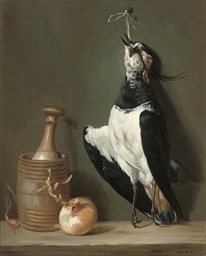 A lapwing suspended from a nai