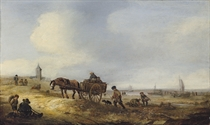 A beach scene with fisherfolk and a horse and cart, a church beyond