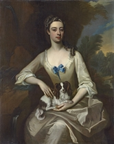 Portrait of a lady, three-quarter-length, seated, in a white dress with a blue ribbon, a dog seated on her lap, in a park landscape