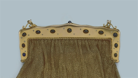 AN ANTIQUE GEM SET GOLD PURSE