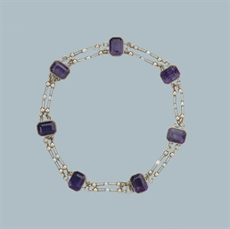AN ANTIQUE AMETHYST AND NATURA