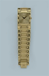 AN 18K GOLD RECTANGULAR WRISTW