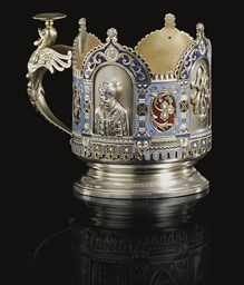 A Parcel-Gilt Silver and Champ