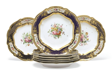 A Set of Eight Porcelain Dinne
