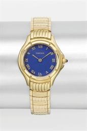 Cartier. A lady's 18K gold ton