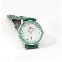 Jaeger-LeCoultre A fine and rare platinum and emerald-set au