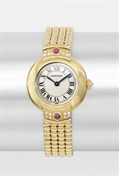 Cartier. A lady's 18K gold, di