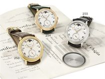 Urban Jürgensen. A fine and rare 18K gold automatic perpetual calendar wristwatch with moon phases