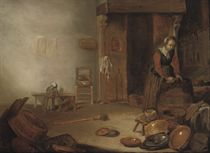 A kitchen interior with a maid cleaning
