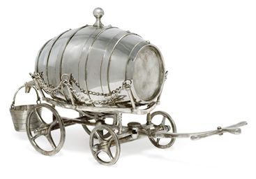 A SILVER-PLATED BARREL DECANTE