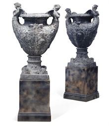 A PAIR OF ENGLISH LEAD URNS