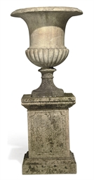 A MARBLE CAMPANA URN ON PEDEST