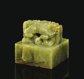 A FINELY CARVED SPINACH JADE S
