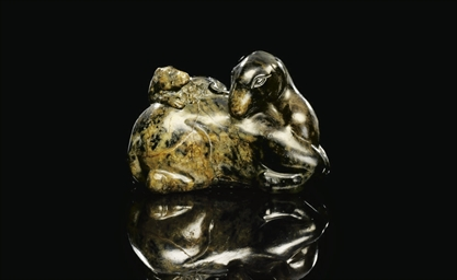 A BLACK AND BROWN JADE GROUP O