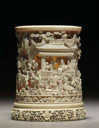 A CARVED AND PIERCED IVORY CYL