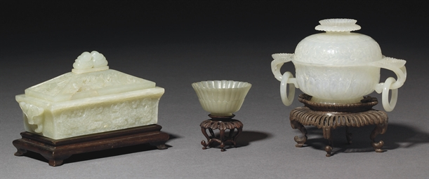 A CELADON JADE BOX AND COVER;