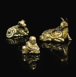 THREE SMALL GILT-BRONZE WEIGHT
