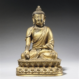 A GILT BRONZE FIGURE OF BUDDHA