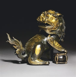 A PARCEL-GILT BRONZE 'BUDDHIST