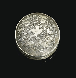 A SMALL CIRCULAR SILVER BOX AN