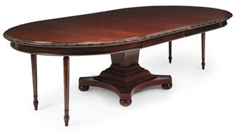 A MAHOGANY EXTENDING DINING-TABLE