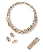A SUITE OF DIAMOND JEWELLERY, BY GARRARD