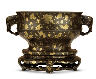 A RARE GILT-SPLASHED BRONZE CE