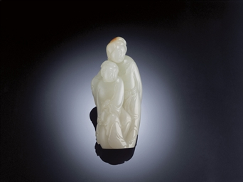 A FINELY CARVED WHITE JADE LAD