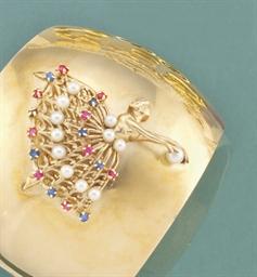 A gem-set bangle