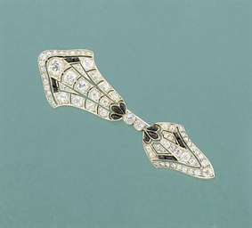 A diamond and onyx brooch