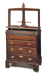 A GEORGE III OAK CHEST WITH CL