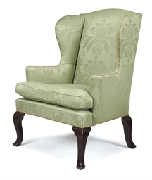 A GEORGE III OAK WING ARMCHAIR