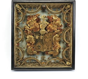 A QUEEN ANNE GILT ROLLED-PAPER