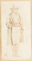 Un homme debout tenant une fau